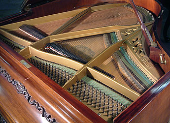 Carl Ecke Grand Piano With A Mahogany Case And Carved