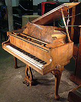 Broadwood Baby Grand Piano For Sale with a walnut case and carvings on legs