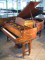 Inlaid, Schiedmayer grand piano for sale. Inlaid with a variety of woods with swags, flowers.