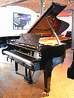 Steinway Model C Grand Piano  with a black case and polyester finish