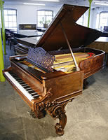 Antique Steinway Concert Grand Piano For Sale with a rosewood case and ornately carved legs