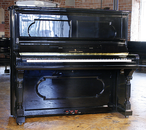 Antique Steinway Upright Piano For Sale With A Black Case
